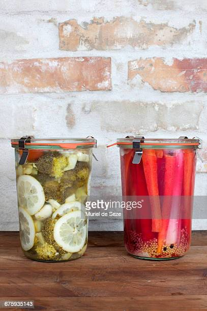 fermented vegetables in glass jars - fermenting stock pictures, royalty-free photos & images