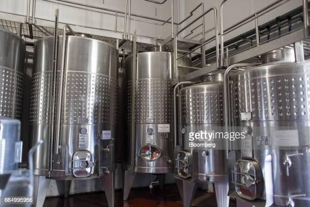 Fermenting tanks stand at the Bodega Santa Julia production facility in Mendoza Argentina on Tuesday March 23 2017 The Argentine wine industry is...