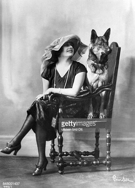 Fern Andra Fern Andra *1893 Actress USA in a wooden armchair with German shepherd dog undated probably 1910 Photographer Atelier Binder Vintage...