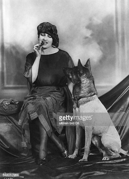 Fern Andra Fern Andra *1893 Actress USA with German shepherd dog and cigar undated probably 1910 Photographer Atelier Binder Vintage property of...