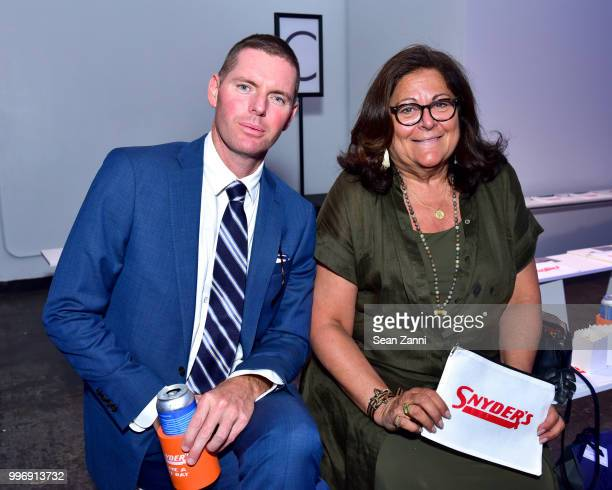 Fern Mallis and Guest attend the Todd Snyder S/S 2019 Collection during NYFW Men's July 2018 at Industria Studios on July 11 2018 in New York City