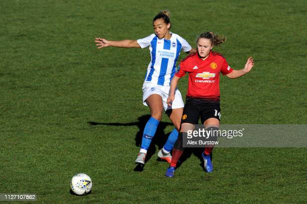 Fern Whelan of Brighton Hove Albion battles for possession with Charlie Devlin of Manchester United during the SSE Women's FA Cup Fourth Round match...