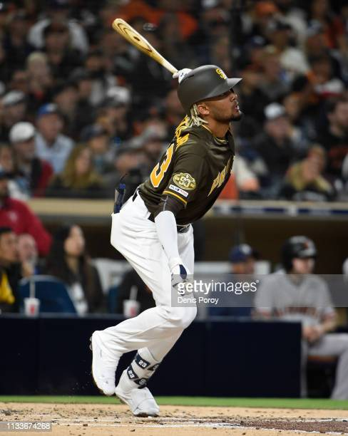 Fernadndo Tatis Jr #23 of the San Diego Padres hits a double during the second inning against the San Francisco Giants at Petco Park March 29 2019 in...