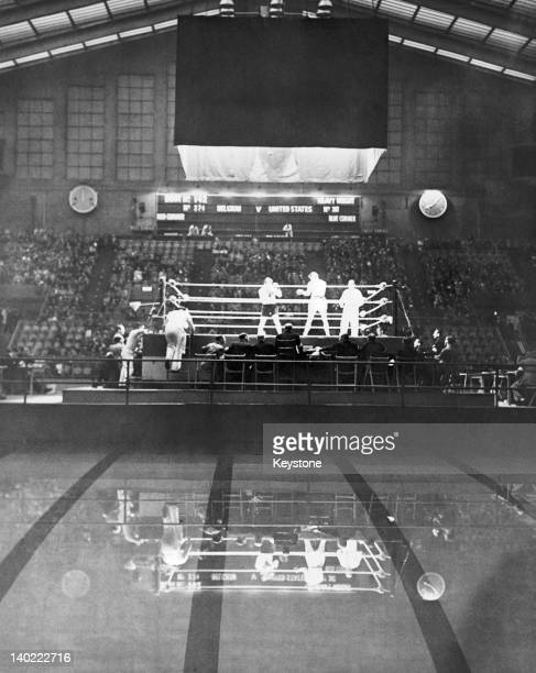 Fernand Bothy of Belgium and Jay Lambert of the USA competing in the men's heavyweight boxing second round at the Empire Pool Wembley during the...