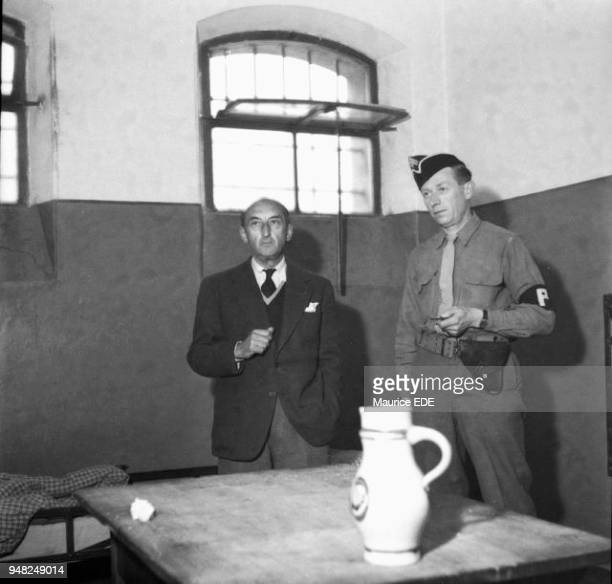 Fernand DE BRINON a former minister of the Vichy government in his cell with a member of the French military police the day after his arrest in...