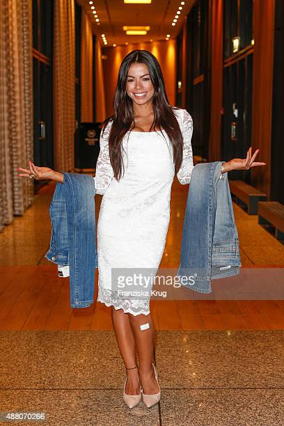 Fernanda Brandao poses with jeans which will be handed over to refugees during the Promi Shopping Queen with Tanja Buelter and Leonie Bechthold on...