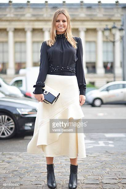 Fernanda Cassou poses wearing a Celine skirt and Chanel clutch and boots before the Chanel show at the Grand Palais during Paris Fashion Week SS16 on...