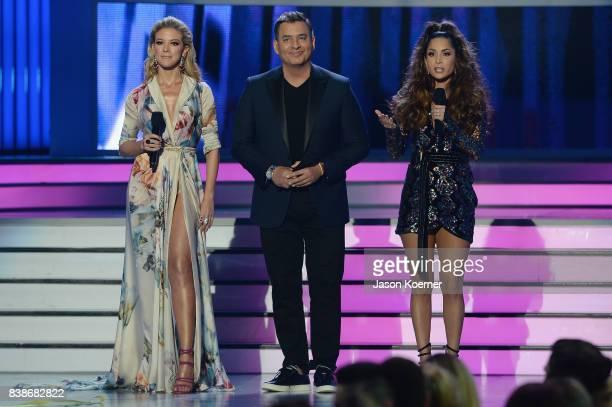 Fernanda Castillo Daniel Sarcos and Carmen Villalobos on stage at Telemundo's 2017 Premios Tu Mundo at American Airlines Arena on August 24 2017 in...