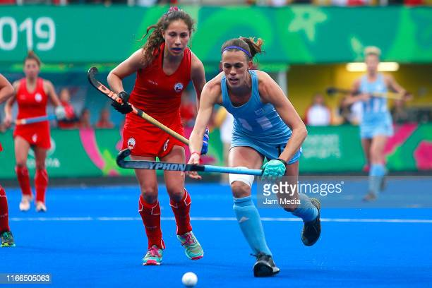 Fernanda Flores of Chile competes for the ball with Carla Rebecchi of Argentina during Hockey Women Semifinals on Day 11 of Lima 2019 Pan American...