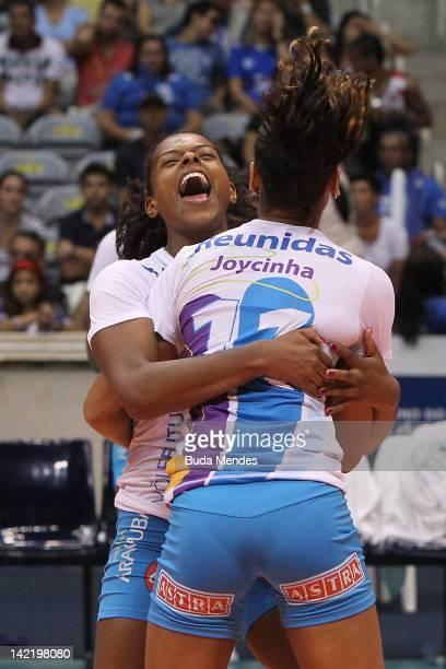 Fernanda Garay and Joycinha of Volei Futuro celebrate a victory during a Women's Volleyball Super League Playoffs   Semifinals at Maracanazinho...