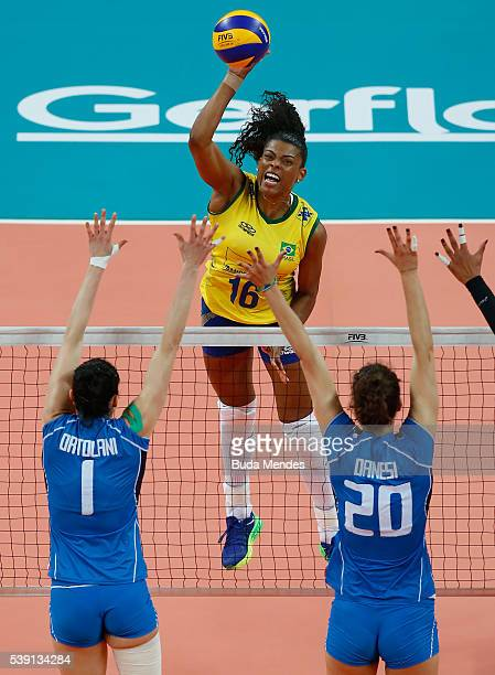 Fernanda Garay of Brazil spikes the ball as Serena Ortolani and Anna Danesi of Italy defend during the match between Brazil and Italy on day 1 the...