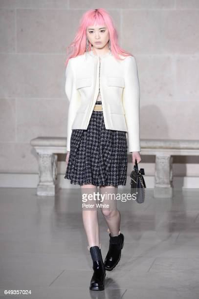 Fernanda Hin Lin Ly walks the runway during the Louis Vuitton show as part of the Paris Fashion Week Womenswear Fall/Winter 2017/2018 on March 7 2017...
