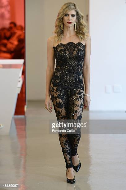 Fernanda Lima attends the Samuel Cirnansck pocket show during Sao Paulo Fashion Week Summer 2014/2015 at the Citroen flagship store on April 1 2014...