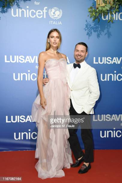 Fernanda Liz and Maxim Sapozhnikov attend the photocall at the Unicef Summer Gala Presented by Luisaviaroma at on August 09 2019 in Porto Cervo Italy