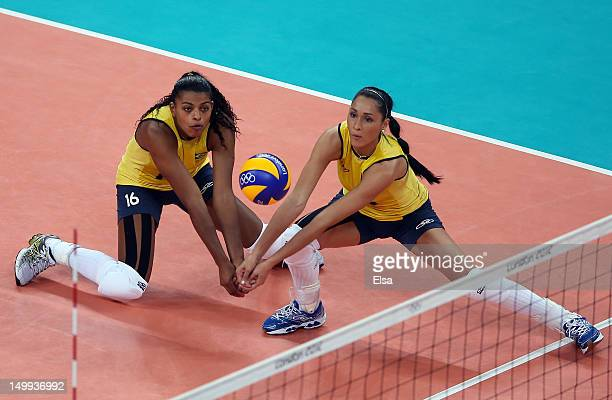 Fernanda Rodrigues and Jaqueline Carvalho of Brazil go after the ball in the second set against Russia during Women's Volleyball on Day 11 of the...