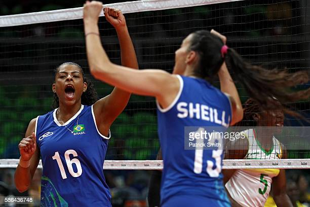 Fernanda Rodrigues of Brazil celebrates a point with teammate Sheilla Castro de Paula Blassioli against Cameroon during the Women's Preliminary Pool...
