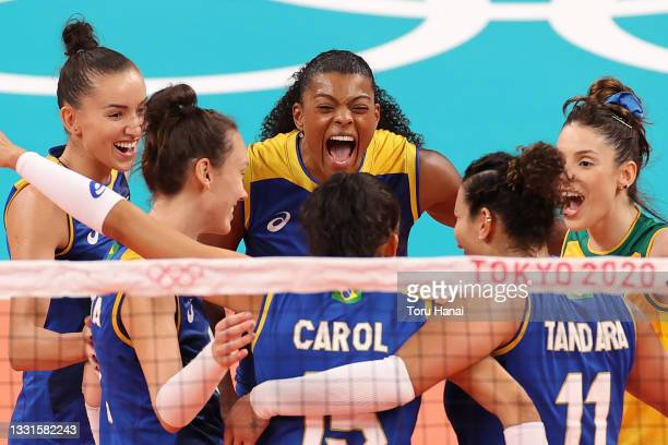 Fernanda Rodrigues of Team Brazil celebrates with teammates after scoring a point against Team Serbia during the Women's Preliminary - Pool A...