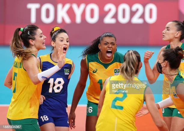 Fernanda Rodrigues of Team Brazil reacts with team mates as they compete against Team ROC during the Women's Quarterfinals volleyball on day twelve...