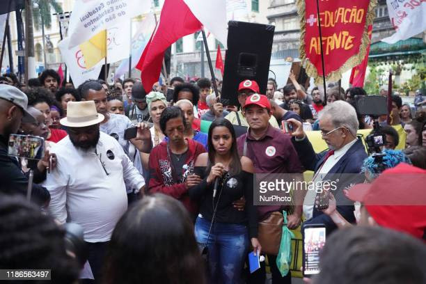 Fernanda Santos, the sister of Dennys Guilherme dos Santos Franca, speaking during a protest about the death of her brother and eight others during a...
