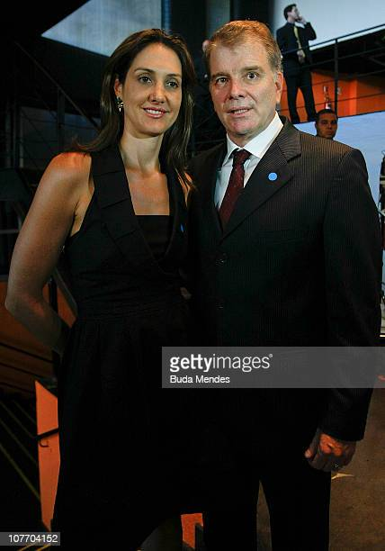 Fernanda Venturini and volleyball coach Vernardo Rezende pose for photographers during the Brasil Olimpico Awards at Theatre of MAM on December 20...