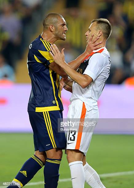 Fernandao of Fenerbahce argues with Vyacheslav Shevchuk of Shaktar Donetsk during UEFA Champions League Third Qualifying Round 1st Leg match betweeen...