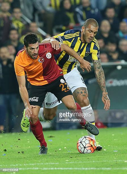 Fernandao of Fenerbahce in action against Hakan Balta of Galatasaray during the Turkish Spor Toto Super League football match between Fenerbahce and...