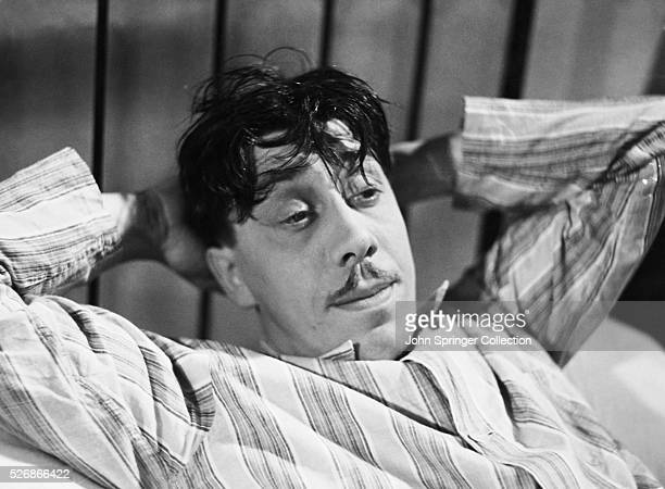 Fernandel Reclining in a Bed