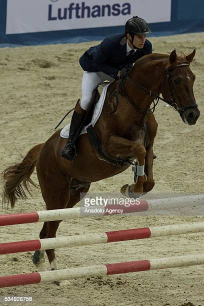 Fernandez Charles of Guatemala competes in the men's riding final at the World Championship in modern pentathlon at the Olympic Sports Complex in...