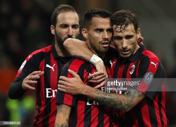 Fernandez Suso of AC Milan celebrates his goal with his teammate Lucas Biglia during the Serie A match between AC Milan and UC Sampdoria at Stadio...