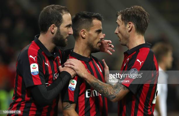 Fernandez Suso of AC Milan celebrates his goal with his teammates Lucas Biglia and Gonzalo Higuain during the Serie A match between AC Milan and UC...