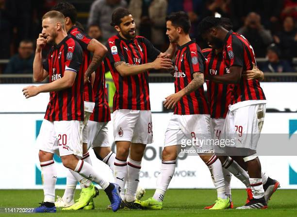 Fernandez Suso of AC Milan celebrates with his teammate Ricardo Rodriguez after scoring the opening goal during the Serie A match between AC Milan...