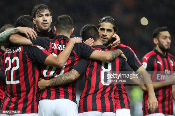Fernandez Suso of AC Milan celebrates with his teammates after scoring the opening goal during the serie A match between AC Milan and Genoa CFC at...