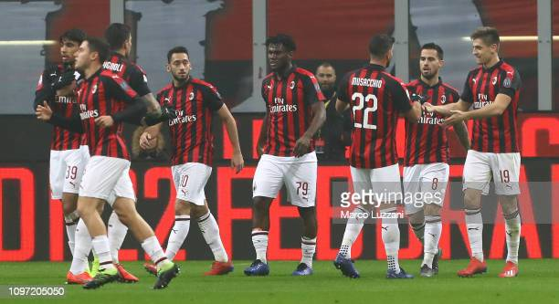 Fernandez Suso of AC Milan celebrates with his teammates after scoring the opening goal during the Serie A match between AC Milan and Cagliari at...