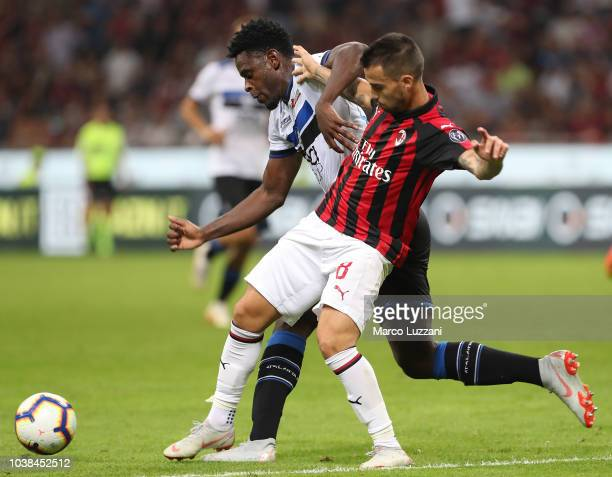 Fernandez Suso of AC Milan competes for the ball with Duvan Zapata of Atalanta BC during the Serie A match between AC Milan and Atalanta BC at Stadio...