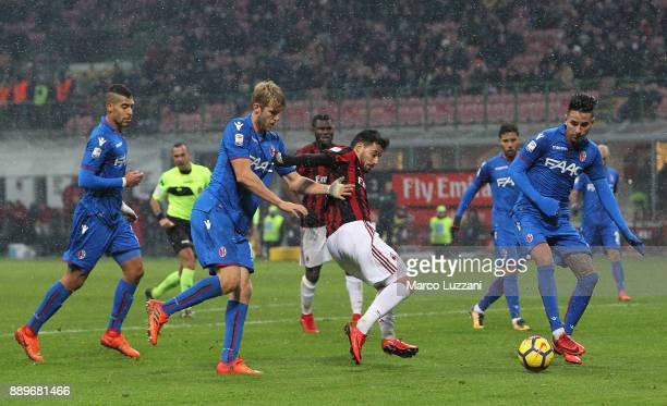 Fernandez Suso of AC Milan competes for the ball with Filip Helander and Erick Pulgar of Bologna FC during the Serie A match between AC Milan and...