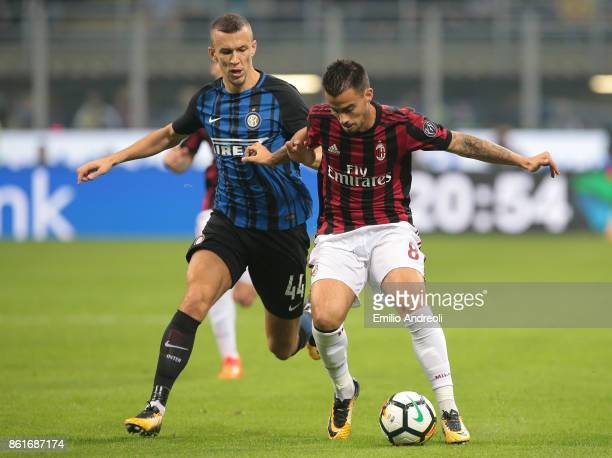 Fernandez Suso of AC Milan competes for the ball with Ivan Perisic of FC Internazionale Milano during the Serie A match between FC Internazionale and...