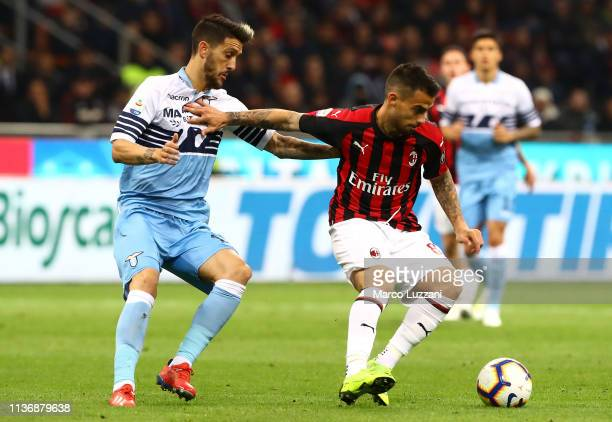 Fernandez Suso of AC Milan competes for the ball with Luis Alberto of SS Lazio during the Serie A match between AC Milan and SS Lazio at Stadio...