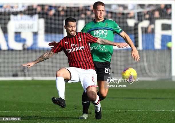 Fernandez Suso of AC Milan competes for the ball with Mario Pasalic of Atalanta BC during the Serie A match between Atalanta BC and AC Milan at...