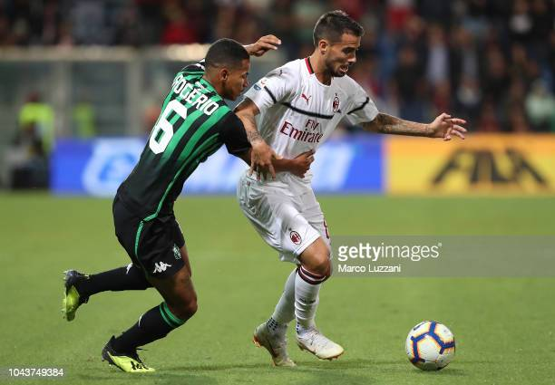 Fernandez Suso of AC Milan competes for the ball with Rogeiro of US Sassuolo during the Serie A match between US Sassuolo and AC Milan at Mapei...