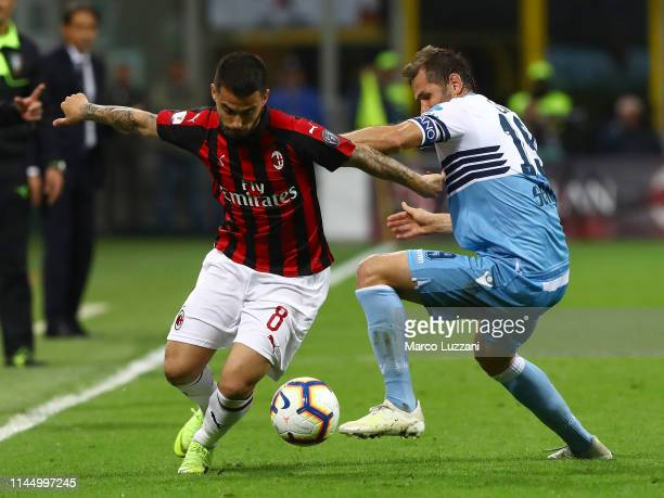 Fernandez Suso of AC Milan competes for the ball with Senad Lulic of SS Lazio during the TIM Cup match between AC Milan and SS Lazio at Stadio...