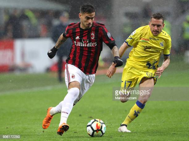 Fernandez Suso of AC Milan is challenged by Emanuele Giaccherini of AC Chievo Verona during the serie A match between AC Milan and AC Chievo Verona...
