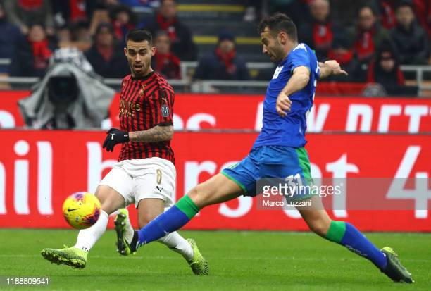Fernandez Suso of AC Milan is challenged by Gianmarco Ferrari of US Sassuolo during the Serie A match between AC Milan and US Sassuolo at Stadio...