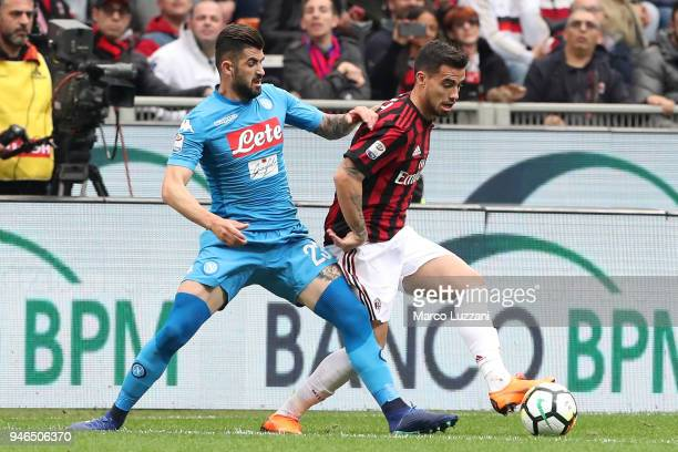 Fernandez Suso of AC Milan is challenged by JElseid Hysaj of SSC Napoli during the serie A match between AC Milan and SSC Napoli at Stadio Giuseppe...