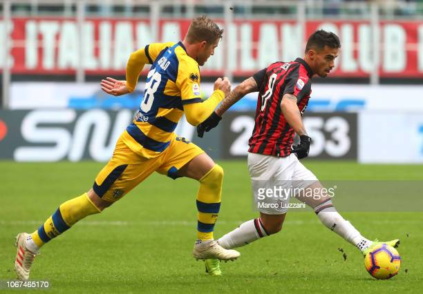 Fernandez Suso of AC Milan is challenged by Riccardo Gagliolo of Parma Calcio during the Serie A match between AC Milan and Parma Calcio at Stadio...