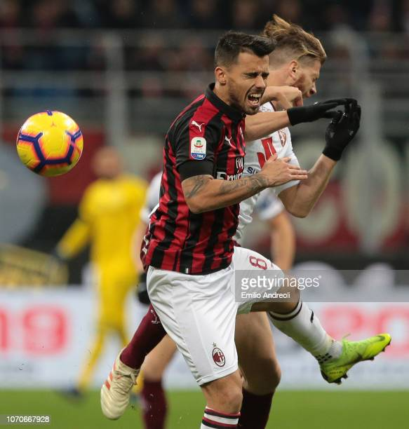 Fernandez Suso of AC Milan jumps for the ball against Cristian Ansaldi of Torino FC during the Serie A match between AC Milan and Torino FC at Stadio...