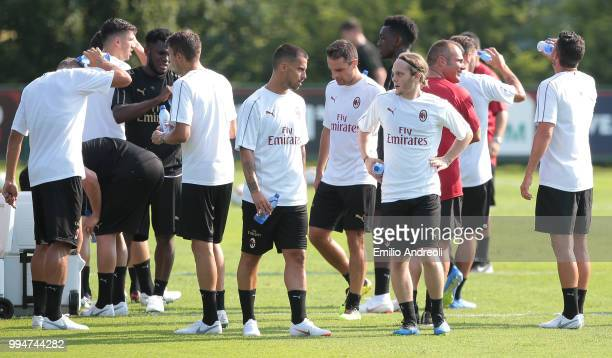 Fernandez Suso of AC Milan speaks with his teammate Alen Halilovic during the AC Milan training session at the club's training ground Milanello on...