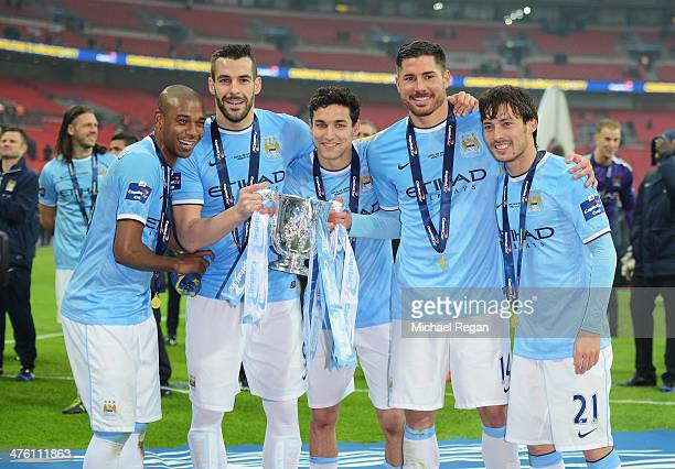 Fernandinho Alvaro Negredo Jesus Navas Javi Garcia and David Silva of Manchester City pose with the trophy after the Capital One Cup Final between...