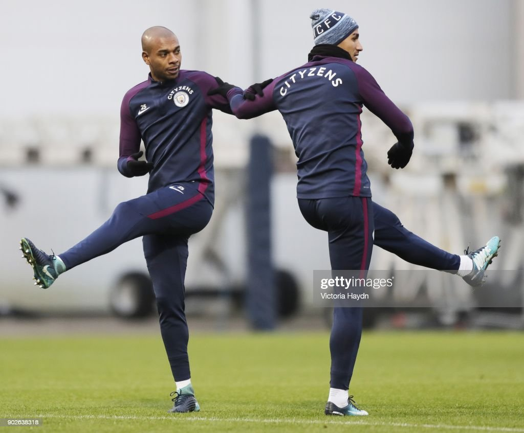Fernandinho and Danilo warm up dueing training at Manchester City Football Academy on January 8, 2018 in Manchester, England.