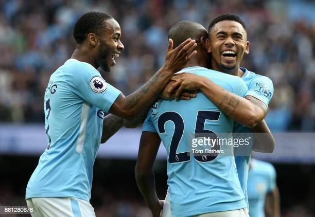 Fernandinho and Gabriel Jesus of Manchester City react during the Premier League match between Manchester City and Stoke City at Etihad Stadium on...