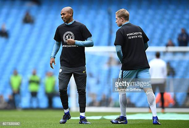 Fernandinho and Kevin De Bruyne of Manchester City wearing tshirts to commemorate the victims of the plane crash involving the Brazilian club...